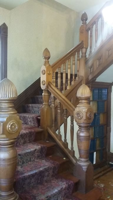 Entrance stairway and secret bookcase