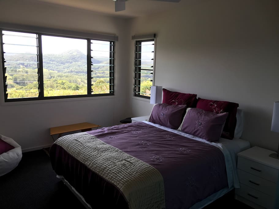Your luxury bedroom, with a panoramic view of mountains.