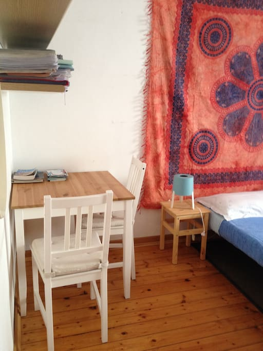 Useful table with chairs in guests room