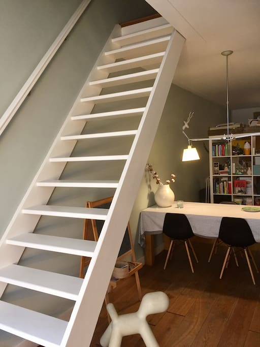 dining table and stairs to second floor