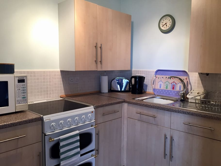 Kitchen fitted with oven, microwave, kettle and toaster