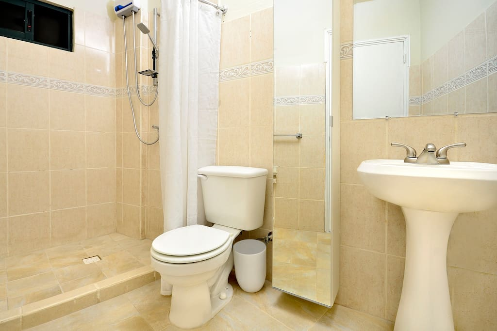 Large stand up shower with hot water. Tall cabinet with plenty of room for putting your toiletries.