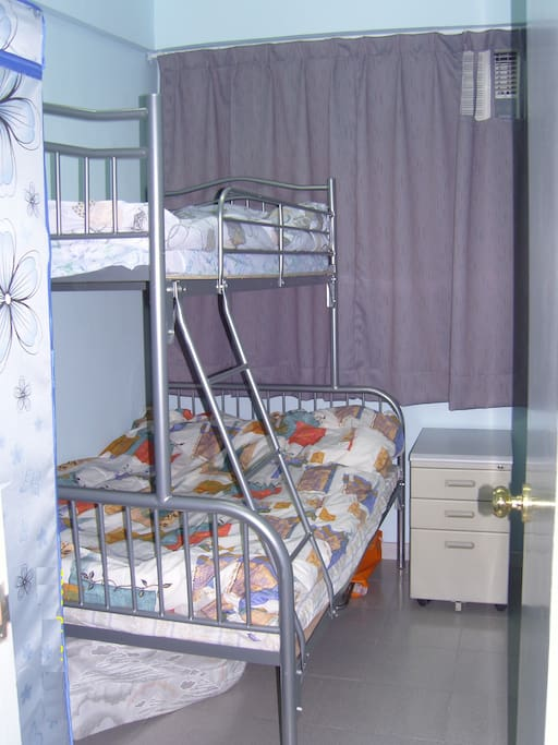Bedroom with bunk bed (double on bottom, single on top).