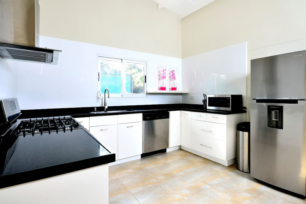 Newly renovated gourmet kitchen. Complete with microwave, coffee maker, toaster, kettle, pots, pans, dishes and cutlery.