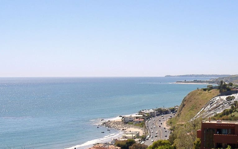 108 degree plus view from Pt. Dume to Santa Monica. Glittering Queens Neclace view at night and Dolphins during the day