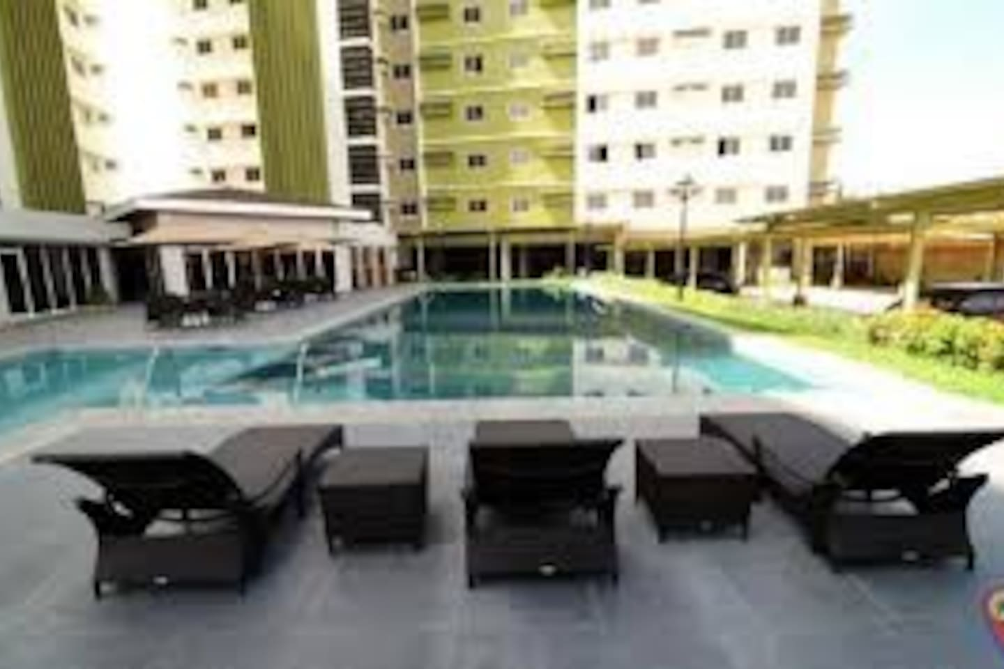 Pool Area. The unit is facing the amenities. This will be your view from the unit. Enjoy the sunshine and relaxing ambiance by the pool.