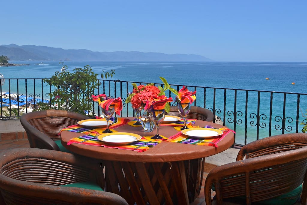 View looking down the beach from private dining patio