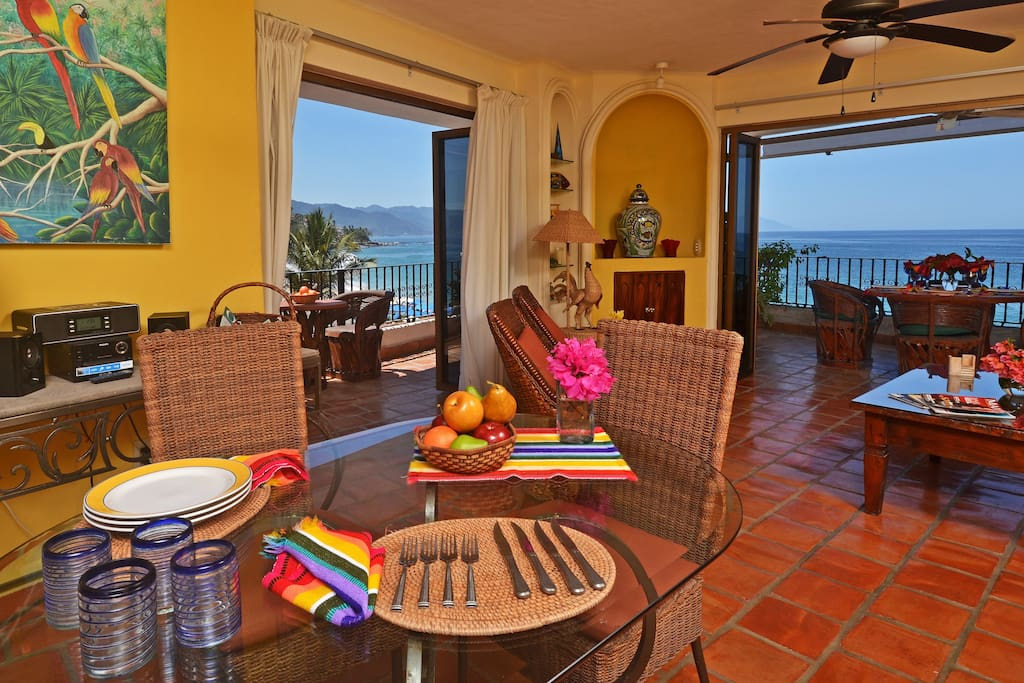View from living room area to outside wrap around private patio and beach views