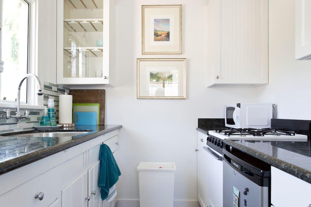 Granite counters in sunny kitchen.