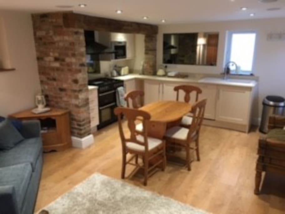 fully equipped kitchen with range , microwave ,fridge/freezer , dishwasher