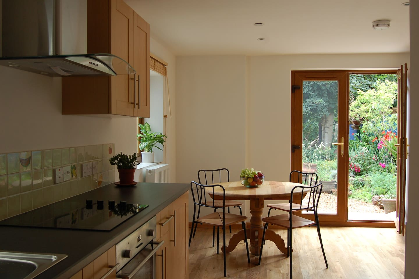 Fully fitted kitchen, dining area, and lounge overlooking colourful garden and a very friendly gardener (my mum!)