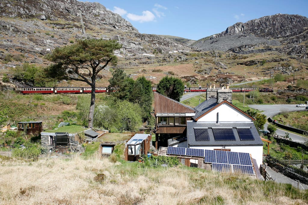 Ffestiniog steam train station 200m. Must wave to trains when they toot,  it is the law
