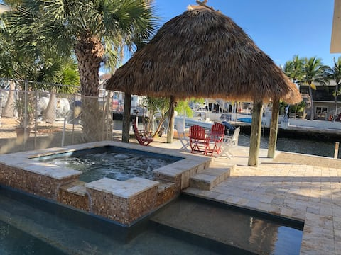 Jacuzzi, Heated Pool, Tiki Hut and deep water canal.