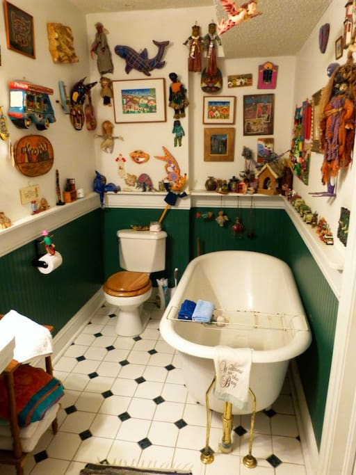 Eclectic  art from around the world. Old clawfoot tub.