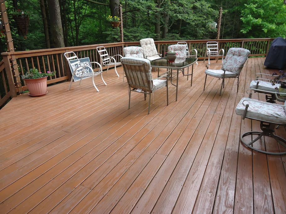 Large deck at the back of house overlooking the ravine and path to the waterfall.