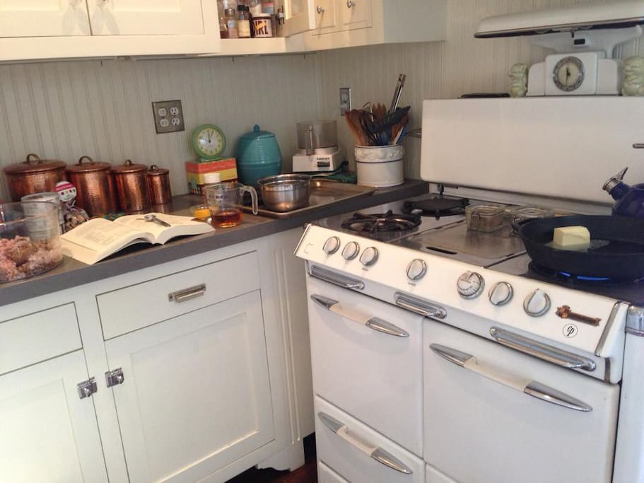 A restored O'Keefe & Merrit oven is the centerpiece of the fully updated kitchen.