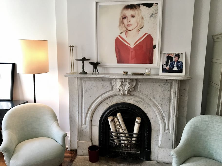 Living room cosy details: Antique decorative fireplace, French antique furnitures and contemporary photographs