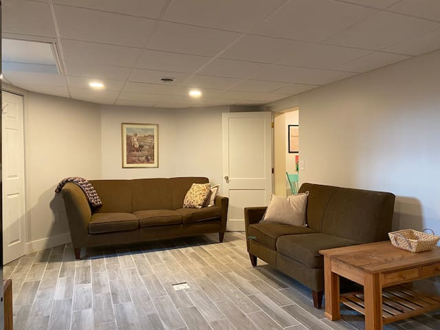 Bright, sunny, and comfortable living area, adjacent to the kitchen.