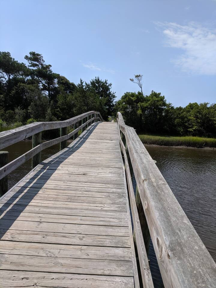 This walkway runs from my house to the beach. It crosses over the Davis Canel, across the marsh on to solid ground as you reach the beach. There is the opportunity to see sea  birds, deer as you walk to the beach
