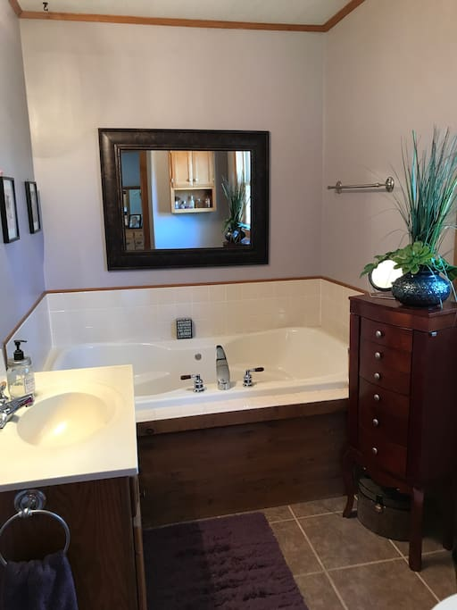 Master bath with shower stall and jacuzzi tub