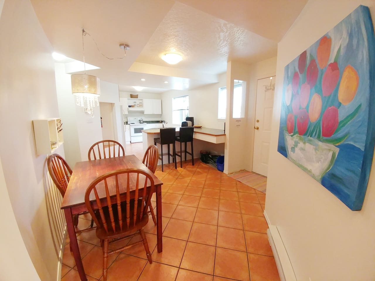 Newly renovated. Looking from the living space towards the dinning areas bright main entrance and spacious kitchen.