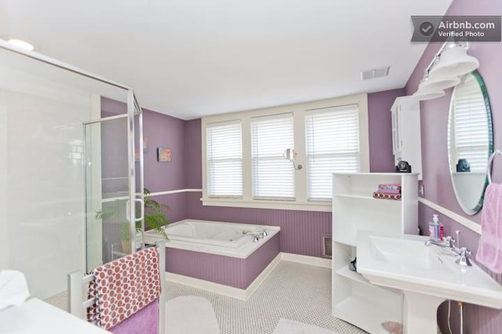 Master bathroom with spacious shower, whirlpool tub, towel warmer and amenities.