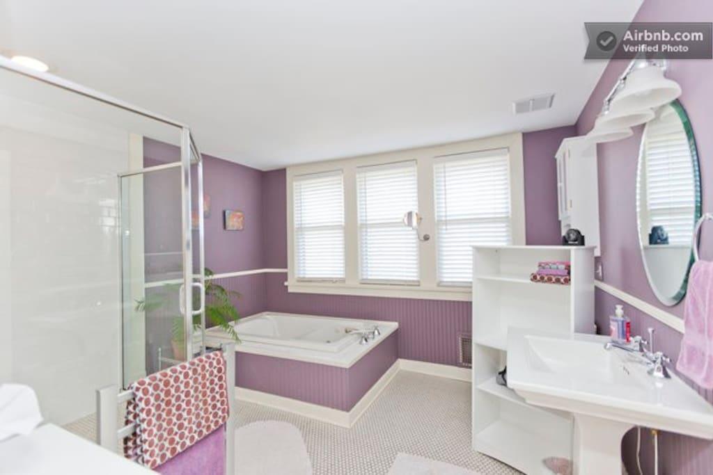 Master bathroom with spacious shower, whirlpool tub, towel warmer and amenities.