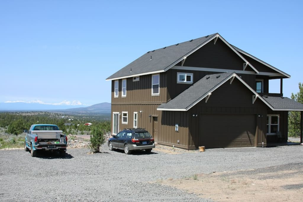 The house has ample parking and a view of Mt. Bachelor, the Three Sisters, Mt. Jefferson, and Smith Rock.