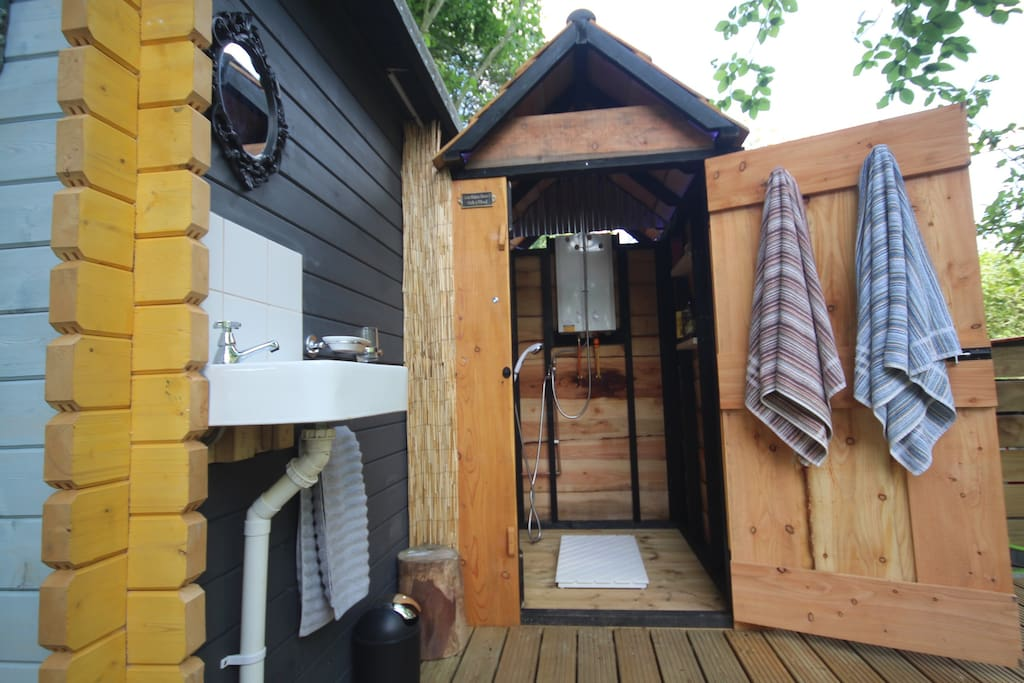 Shower and the outdoor Goatee Shave & Handwash Station. Endless hot water.