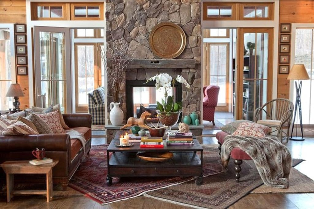 great room replete w/ social gathering areas incl massive double-sided fireplace