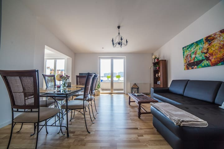 77 m2 apartment. It has 1 master bedroom with a double bed. The living room/lounge area has two double sofabeds, allowing 6 persons in total, 3x2.