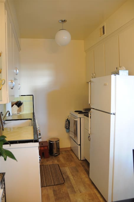 Kitchen stocked with all essential dishes and many electrical appliances (listed in details) - no dishwasher.