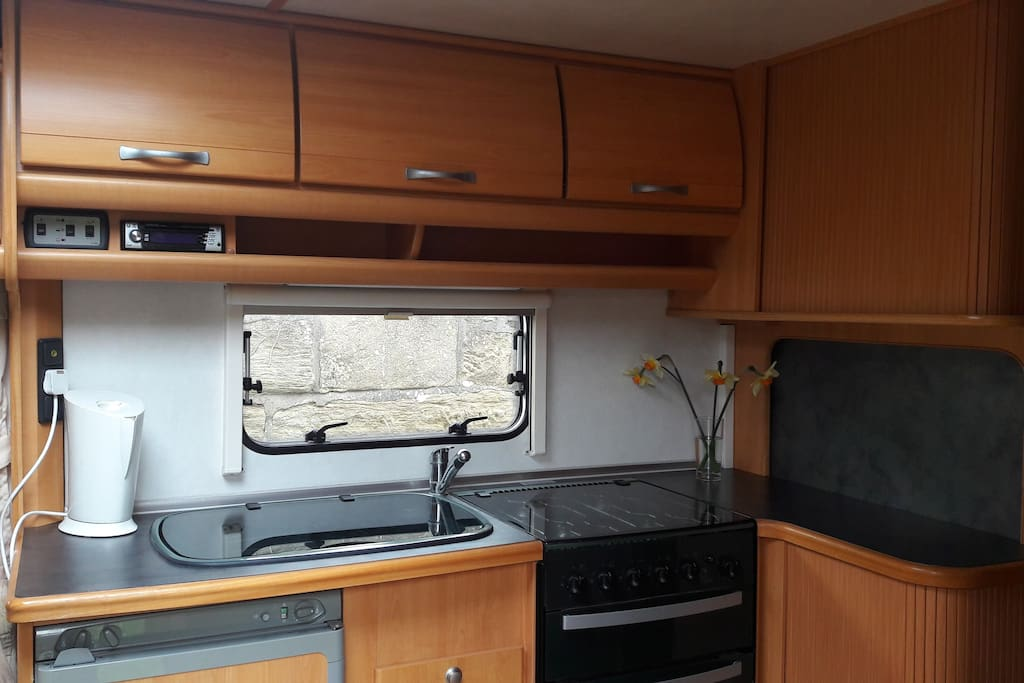 fully equipped kitchen including fridge-freezer, 4-burner hob and oven