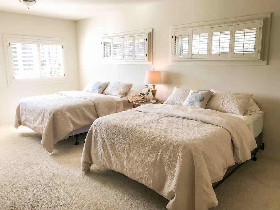 Two queen beds in bedroom can sleep up to four guests.