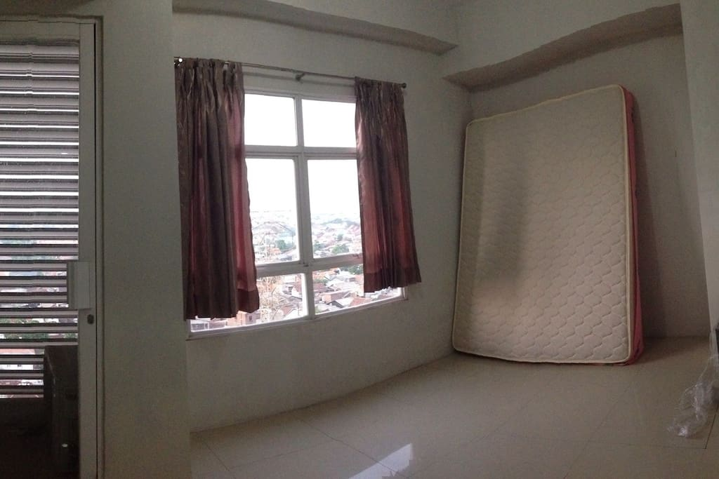 The bedroom, while the bed would be pulled down and prepared prior to your stay :)