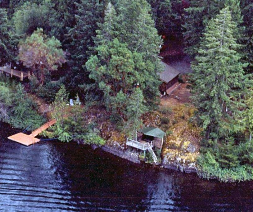 Aerial view of private dock, Detached Cabana and Cabin behind.