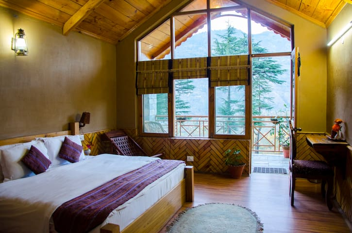 Bed room with Balcony. Enjoy the open view of snow covered mountains