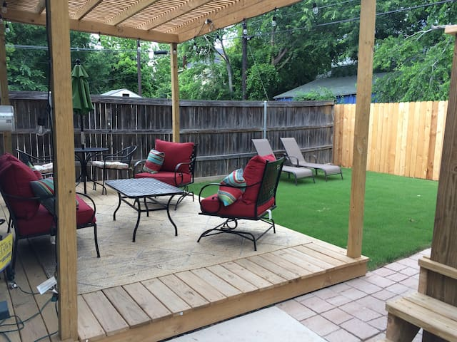 Private and quiet back yard with patio/deck seating to enjoy the evening.