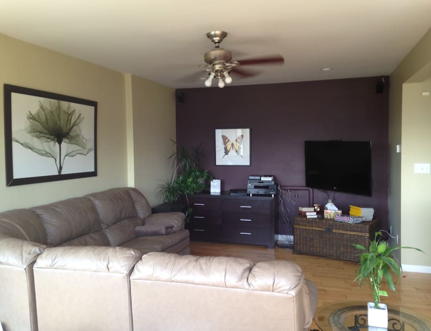 Living room is open to kitchen with island in between, great family entertainment