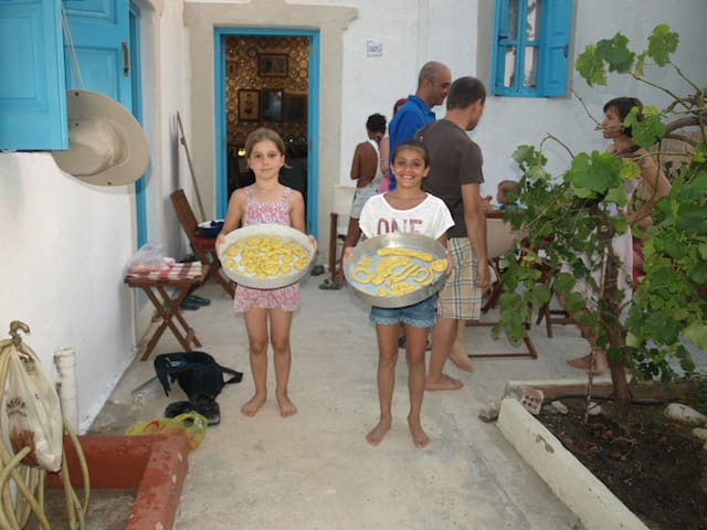 "...baking traditional bread and cookies.Encouraging our guests to live the experience of the local tradition. ""Two arch type houses in Archangelos Rhodes - Ambassadors of Hellenic culture."