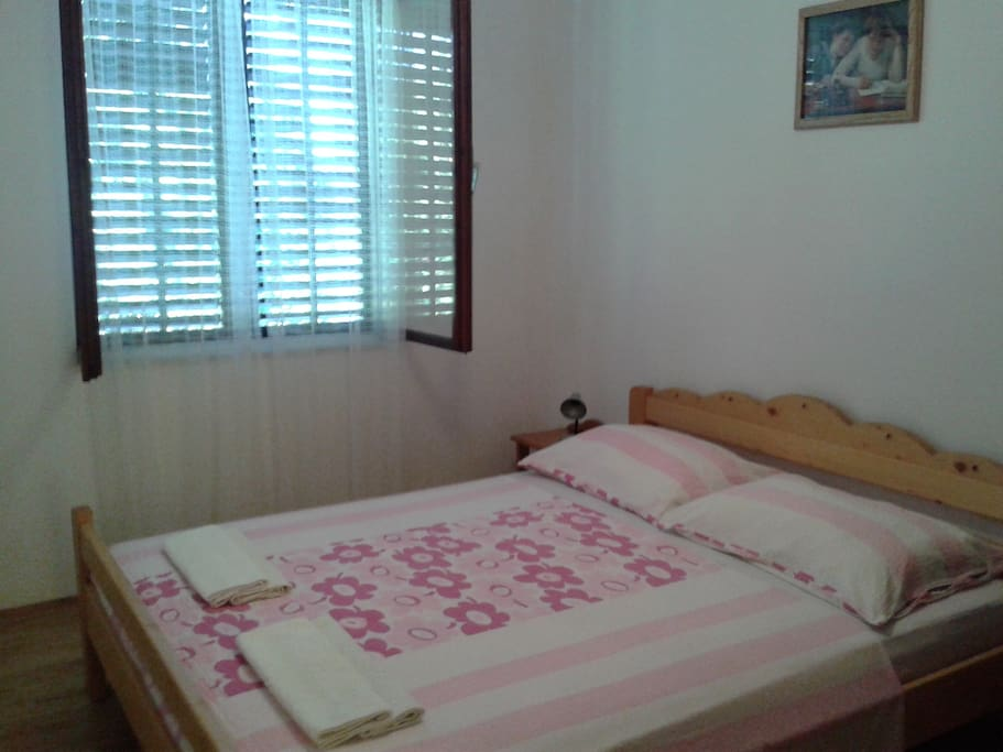 One of two double-bed rooms