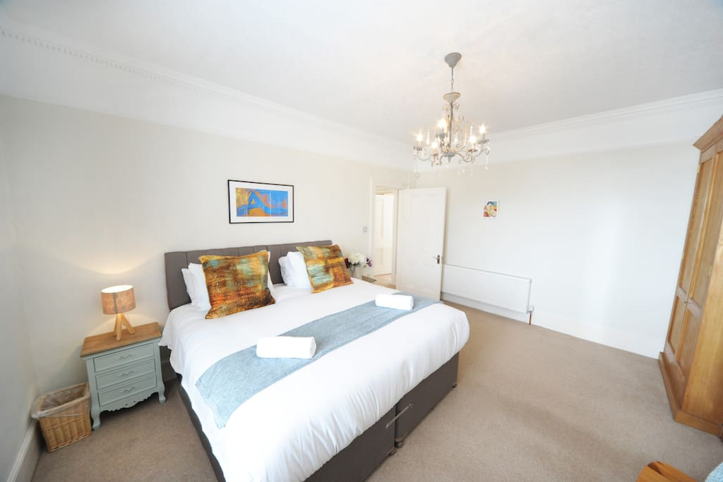 The middle floor bedroom is very spacious and delightfully decorated with chandelier and matching duck-egg bedside tables. Can be twin beds or a super-king with zip-link mattresses.