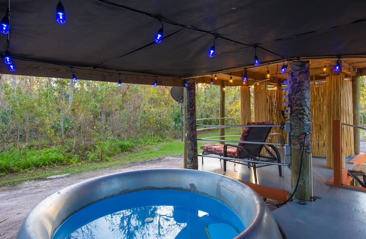 Hot tub deck with outdoor shower in background