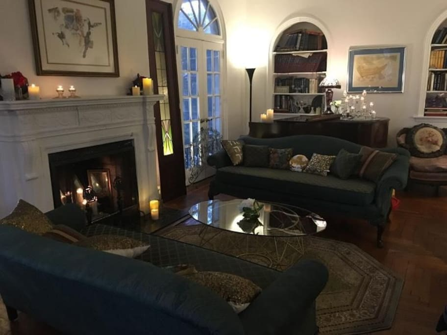One of the many open areas of the house, this relaxing living room has comfortable couches, bay windows and a fantastic ambiance.