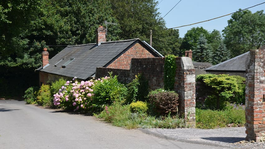 The house is reached via a small private road, has plenty of parking but a sharp entrance