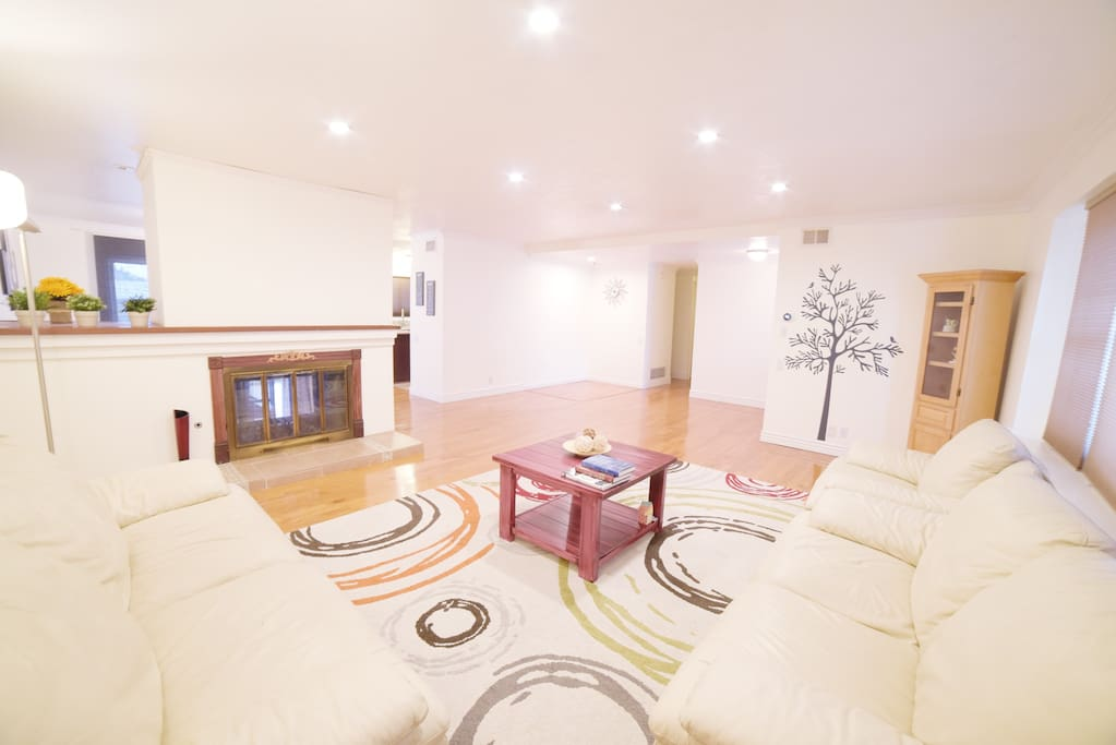 Spacious and laid back living room with hardwood floor all around