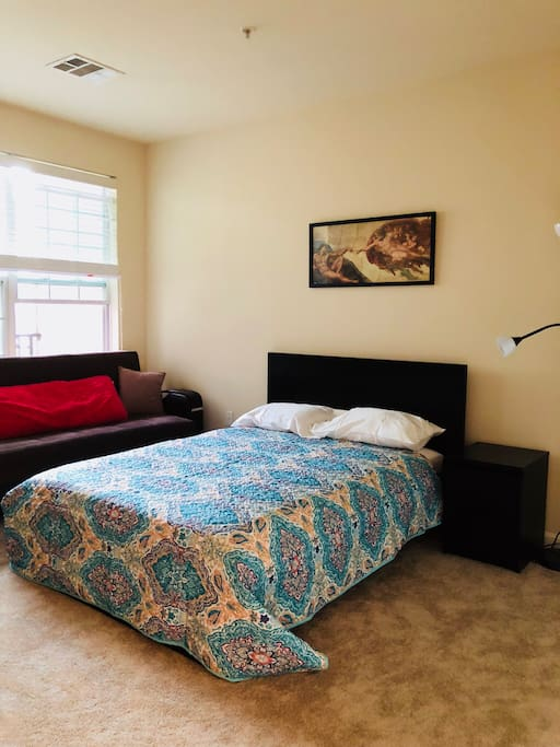 Ample renovated bedroom with double bed and couch bed