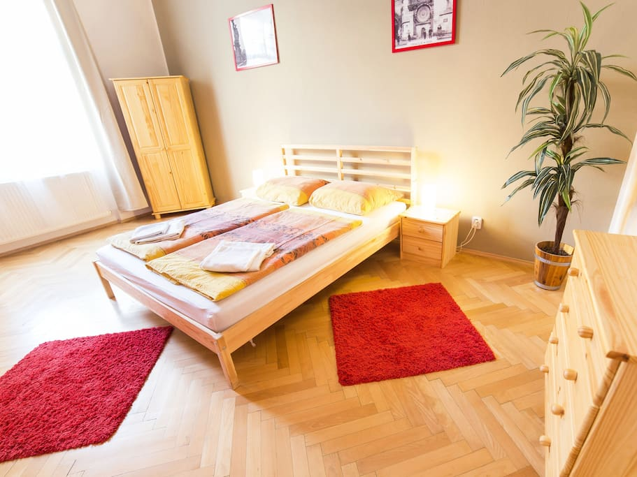 2nd bedroom with double bed and 2 single beds