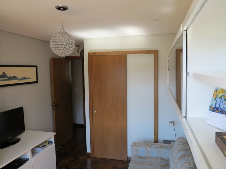 Sliding door leads to private bathroom.