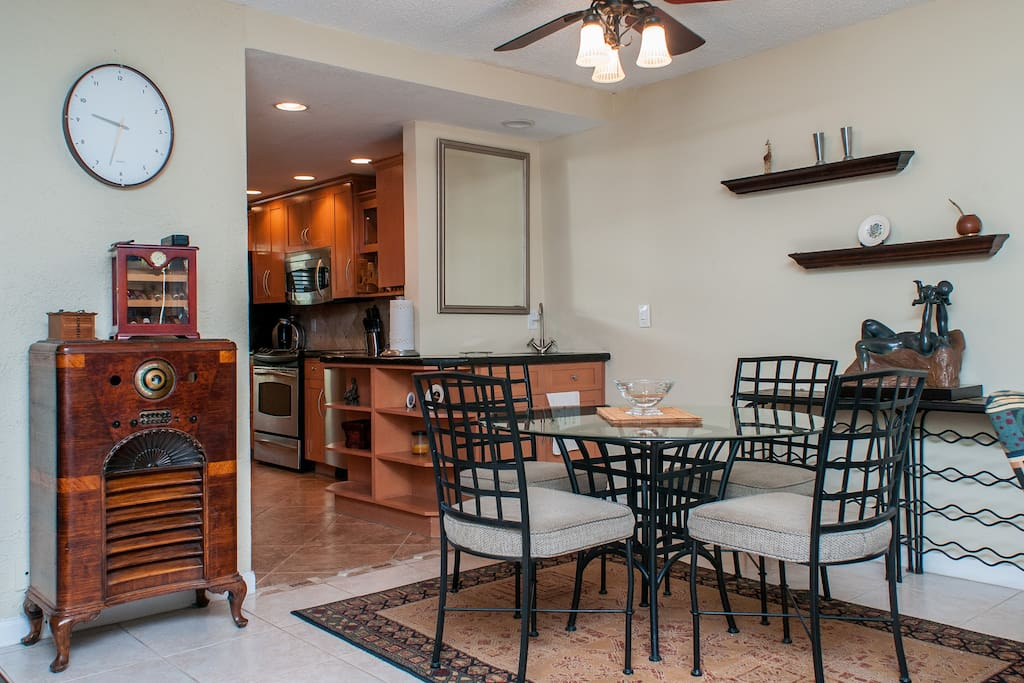 Dining area with wet bar and kitchen in background